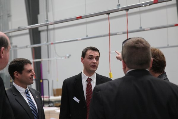 CEO Marcel Ruhland (center) talks with visitors at the company's new facility on Oct. 30, 2013.